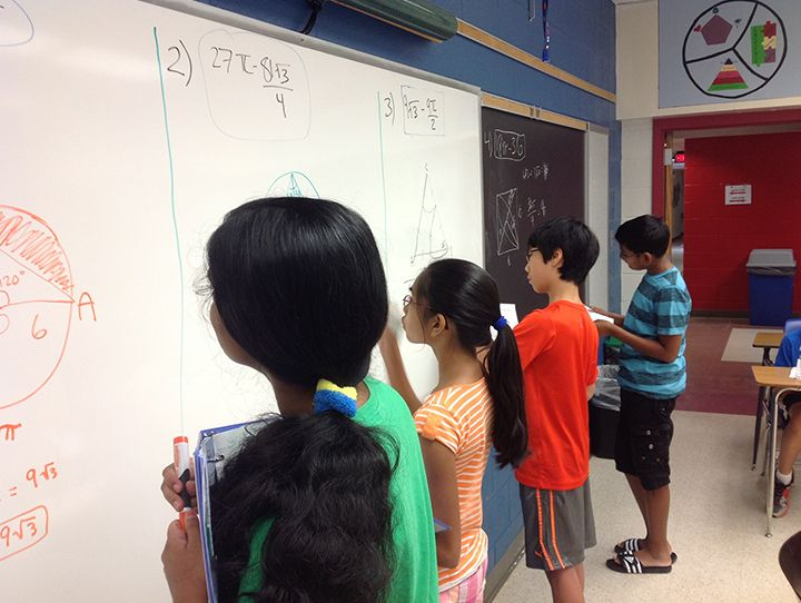 students-solving-geometry-problems-on-board.jpg